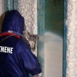 Worker spraying insulation