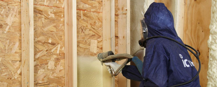 Air Barrier Insulation Systems employee insulating a home