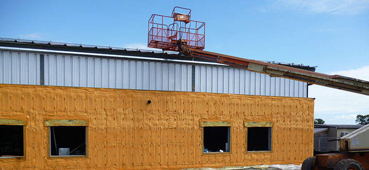 Air Barrier Insulation employees working on a school