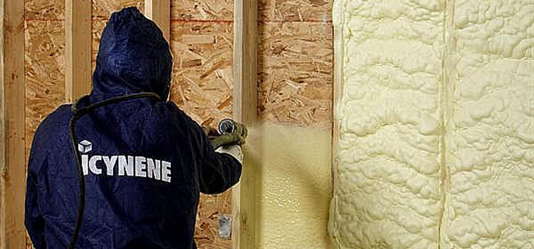 An Air Barrier Insulation employee spraying insulation